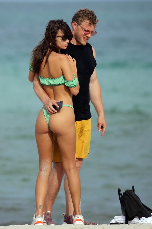 Emily-Ratajkowski-hits-the-beach-in-Miami-in-a-tiny-green-bikini-with-husband-a6qm1woay2.jpg
