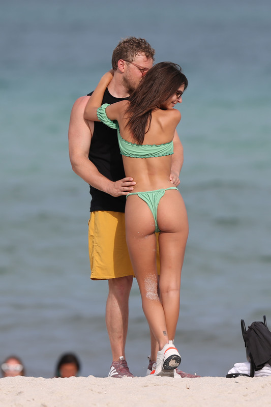 Emily-Ratajkowski-hits-the-beach-in-Miami-in-a-tiny-green-bikini-with-husband-k6qm1x03t4.jpg
